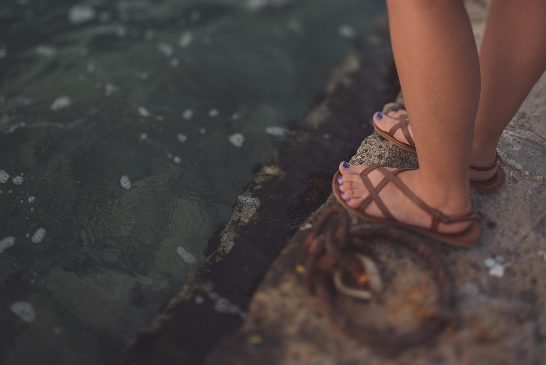 Feet in the Venetian Harbor of Chania