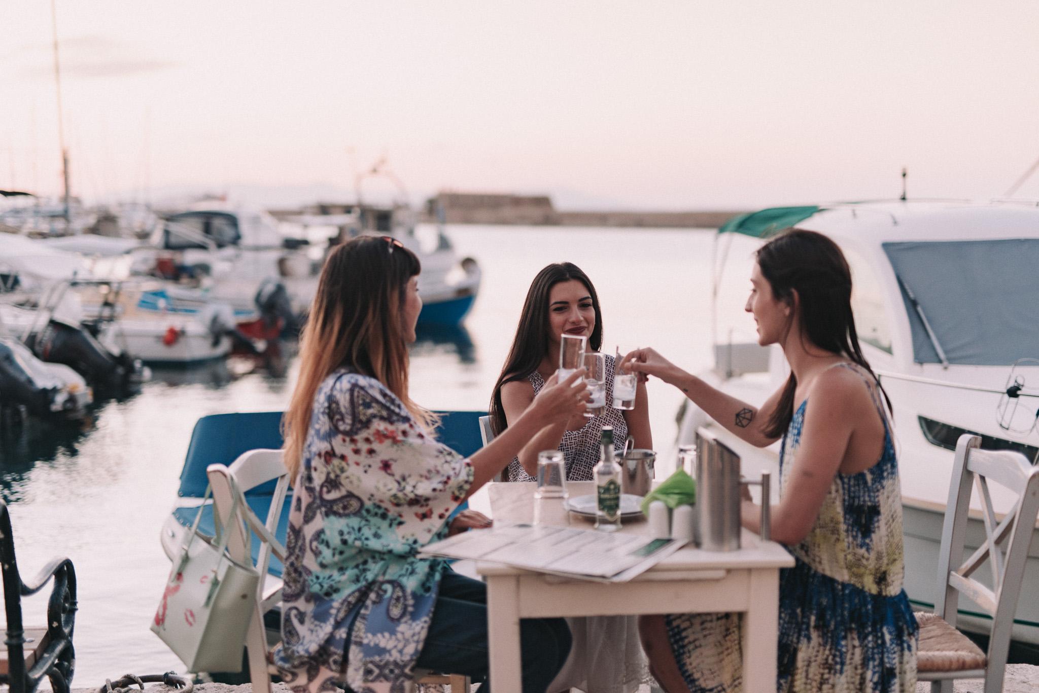 Girls having dinner in the Venetian Harbor of Chania Crete