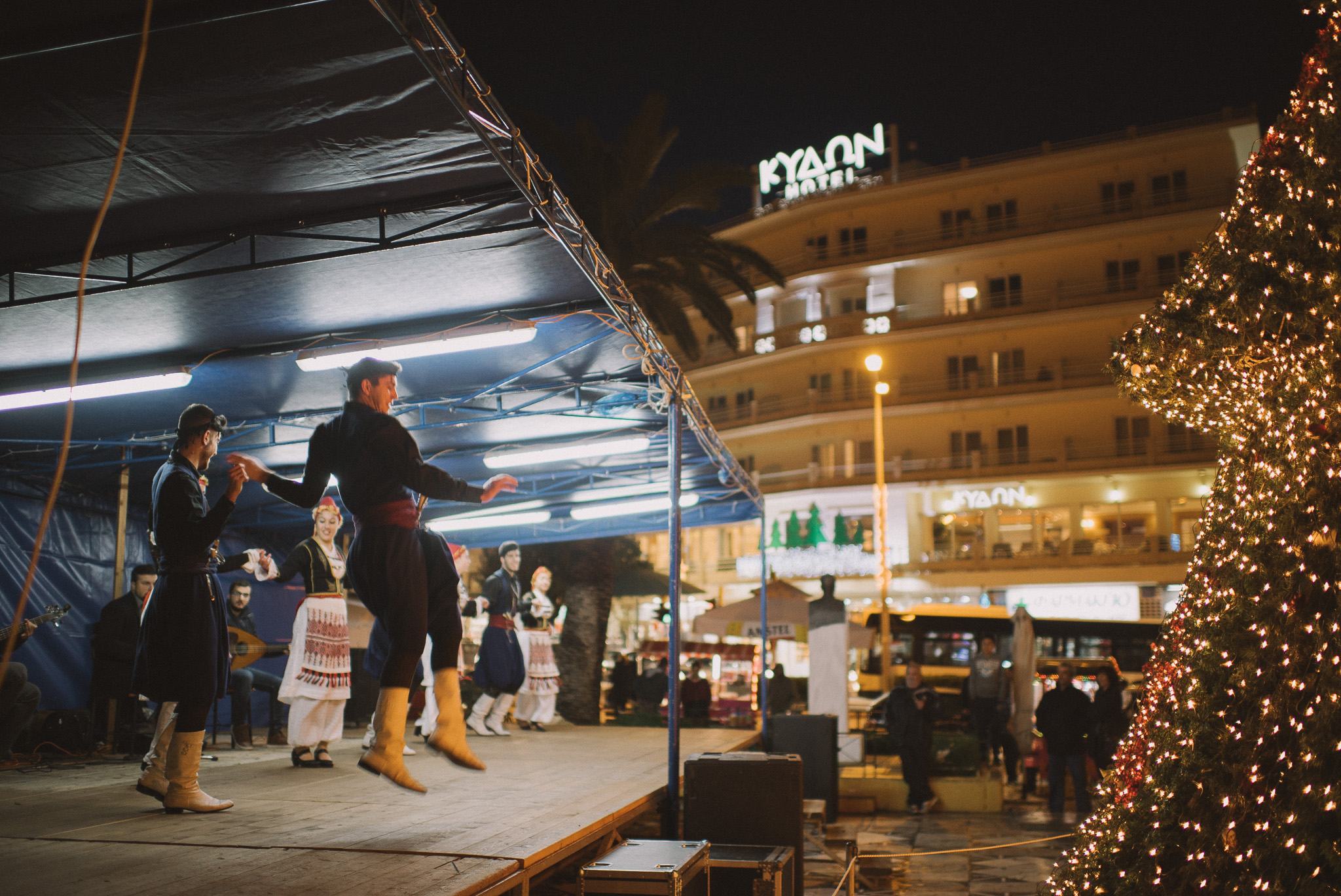 Cretan dancers in front of the old market. Just a few hours before the new year.